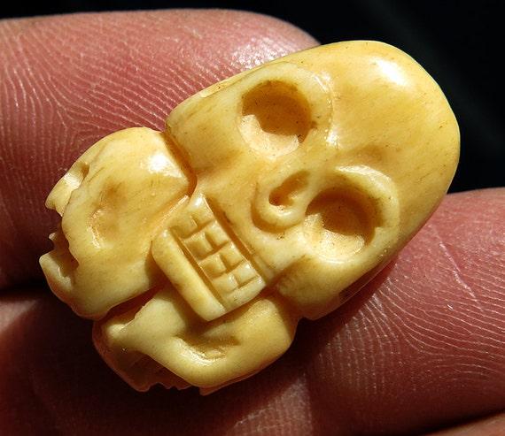 Old Hand Carved Bone Skulls Carving. 2-side, 4 skulls front and back