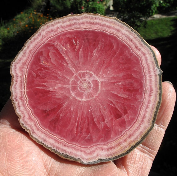 Sale Highest quality Rhodochrosite slice. Offering a perfect 3 3/8 across full edge round Polished 2 side. No chips no cracks