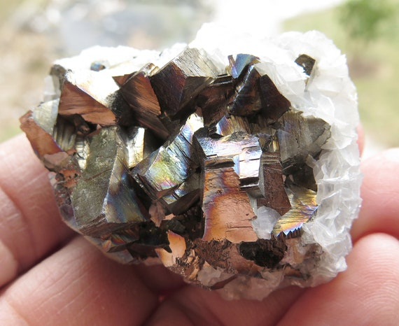 Iridescent Pyrite with calcite back. Shangbao Mine, Leiyang Co, Hunan Province, China 2 1/8 inch across
