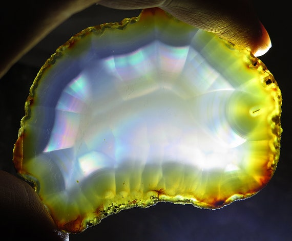 Not a usual agate. A polished 3 5/8 inch Rainbow Iris Agate, variety of Chalcedony. Mined in Indonesia