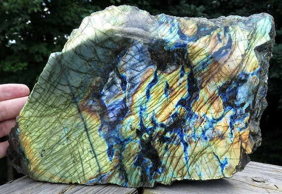 A High quality Labradorite showpiece with 100% flash of gold and blue. 11 by 7.5 by 3 inches deep. Madagascar 14.5 pounds