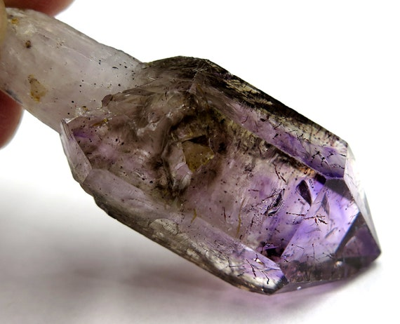 A Natural Gem Glassy Amethyst Quartz Crystal with a hint of purple and smoke and hematite flakes 24.4 gram 58 x 20mm. Zimbabwe