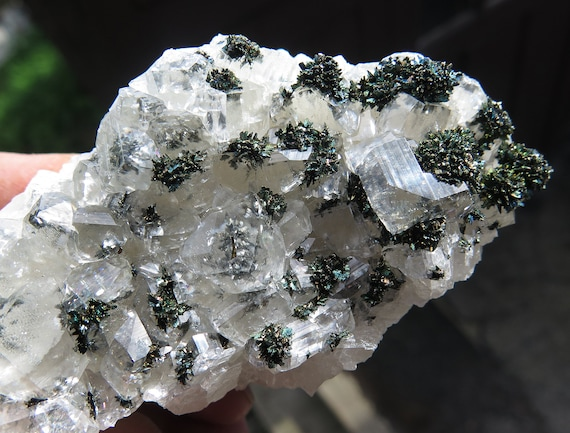 Iridescent Marcasite on and in Calcite. Linwood mine, Buffalo, Scott County, Iowa USA. 5 inch long
