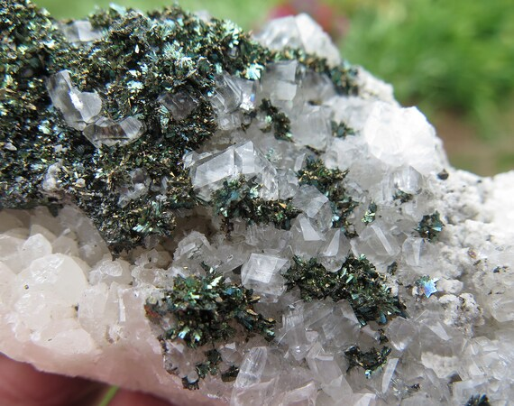 Iridescent Marcasite on and in Calcite. Linwood mine, Buffalo, Scott County, Iowa USA. 4.5 inch long