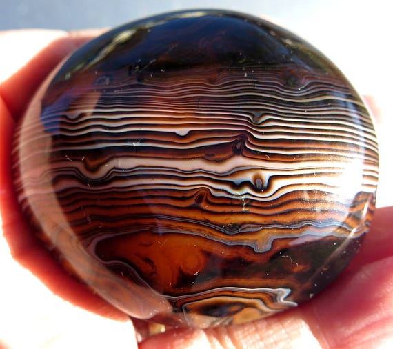 Highly Polished Banded Agate Freeform. 2.5 inches long with super Luster Polish. High Grade