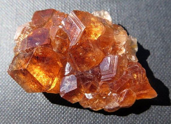 Gemmy, lustrous transparent, cinnamon-colored grossular garnet cluster, Jeffrey quarry, Asbestos, Quebec, Canada 25.3g