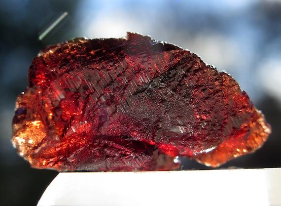 Hold Claudia. Stepped formation Spessartine Garnet crystal from Navegadora mine, Brazil 10.8 g