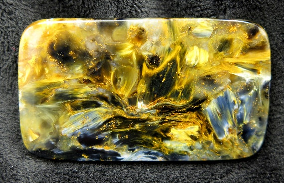 13.2 gram Pietersite cabochon 2 inches long. Cut polished material from Namibia