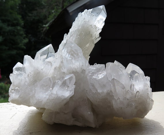 From our collection. An outstanding large cabinet Candle Quartz. Main point alone is 6 inches tall. Shows all around