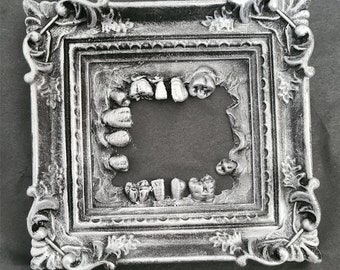 Oddities - Silver Teeth Frame - Slight Damage