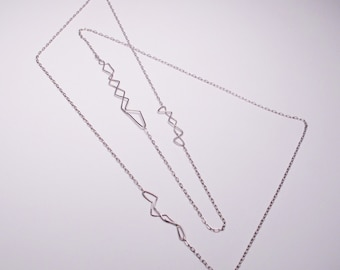 Long sterling silver necklace with jagged connections