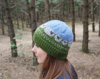 Winter knitted wool beanie hat with sheep pattern. Warm patterned alpaca wool winter hat.