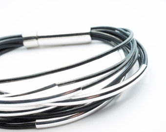 Multi Strand Black Leather Bracelet . Sterling Silver Tubes . Stainless Steel Closure . Rustic .
