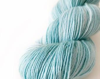 "Superwash Merino Yarn . Fingering . Kettle Dyed . 400 yards . 100 g . Wild Lilac Moon's Moonlight in color ""Ocean Breeze"""