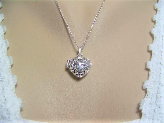 Vintage style filigree bronze wish locket necklace can hold gemstone or keepsake