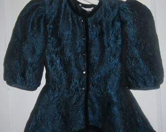 Turquoise girls blouse or jacket reduced to half price of 10 dollars in our Spring Madness sale