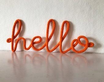 "Small ""hello"" crochet yarn cursive wire wall word"