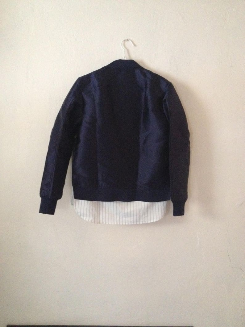 Dark Navy Blue Shiny Bomber Jacket Striped Shirt Lining Silver Zips Minimal Trend