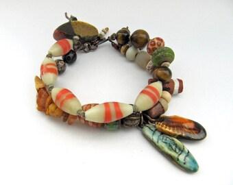 Wranglings- rustic double-strand bracelet w/ art beads, gemstones & more; unique ooak earthy orange autumnal mixed media assemblage bracelet