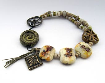 Turning The Bones - rustic off-white and olive green bracelet w/ artisan beads; grungy tribal primitive post-apocalyptic assemblage bracelet