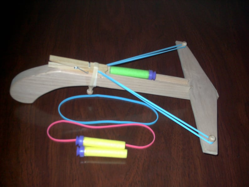 Wooden crossbow that shoots nerf darts