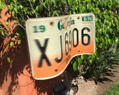 Wind Spinner from old License Plate - random state