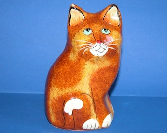 Vintage hand painted Ginger Tabby cat with one of those looks......