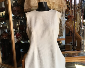 White Sleeveless Dress with Ruffle along Bottom Lined
