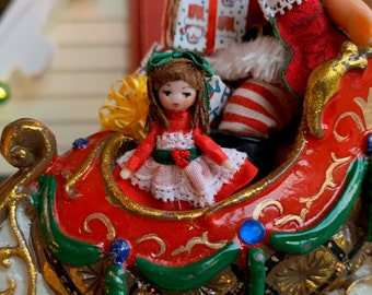Tiny Porcelain Christmas Dolly