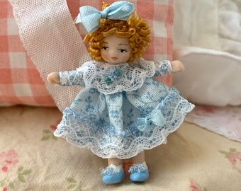 Tiny Porcelain Red Haired Dolly