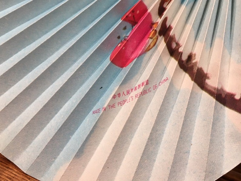 Vintage oriental paper folding hand fan with cherry blossoms