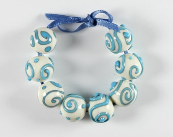 Ivory Glass Beads Turquoise Scrolled Round Lampwork Set