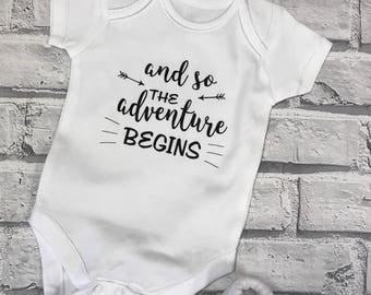 And so the adventure begins, baby vest Adventure baby vest. Baby shower, Baby announcement. Gender netural baby vest. Slogan baby vest.