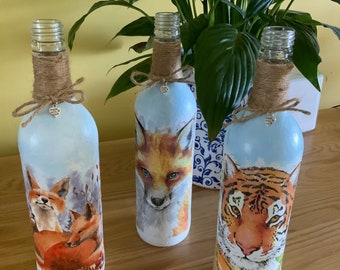Wildlife collection Tigers and Foxes decorated and decoupaged on wine bottles with made with love Tibetan silver hearts