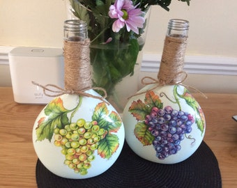 Grapevine decorated painted and decoupaged wine bottles