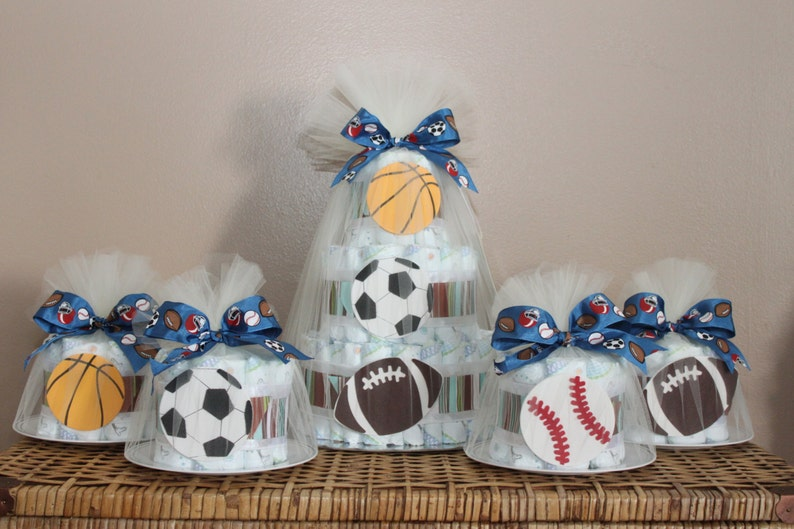 Sports themed diaper cake centerpiece and four smaller cakes image 0