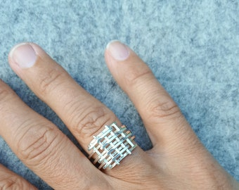 Silver statement ring with subtle line play design