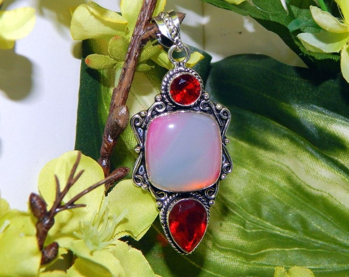 Alluring Dreamscape Vampire inspired vessel - Handcrafted Pink Agate pendant necklace