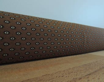 Brown draft Stopper. Light blocker. Door or window snake. Draught excluder. House and home accessory. energy saver. window draft stopper.