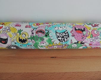 Monsters. Door draft Stopper. Door or window snake. Draught excluder. House and home accessory.eco friendly energy saver