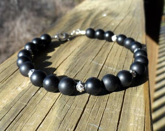 Men's Matt OnyxGemstone Bracelet with Tierra Cast Antique Silver Spacer Beads and Lobster Clasp