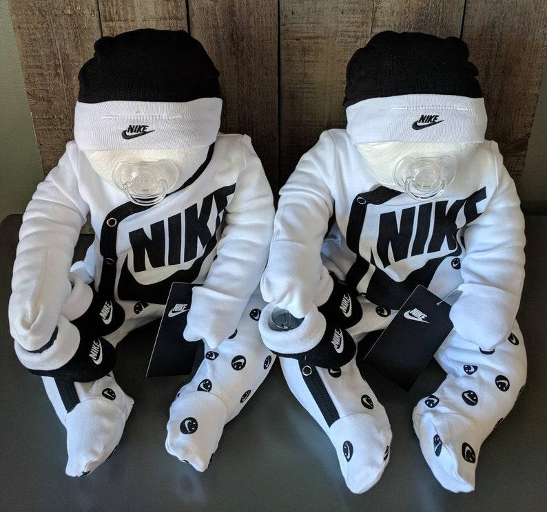 6fc157c864be Baby shower centerpiece diaper cake baby super cute Nike