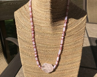 Pink necklace with polished rose quartz focal