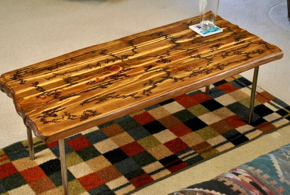 Fractal burned metal leg coffee table with distressed top 41 inches long