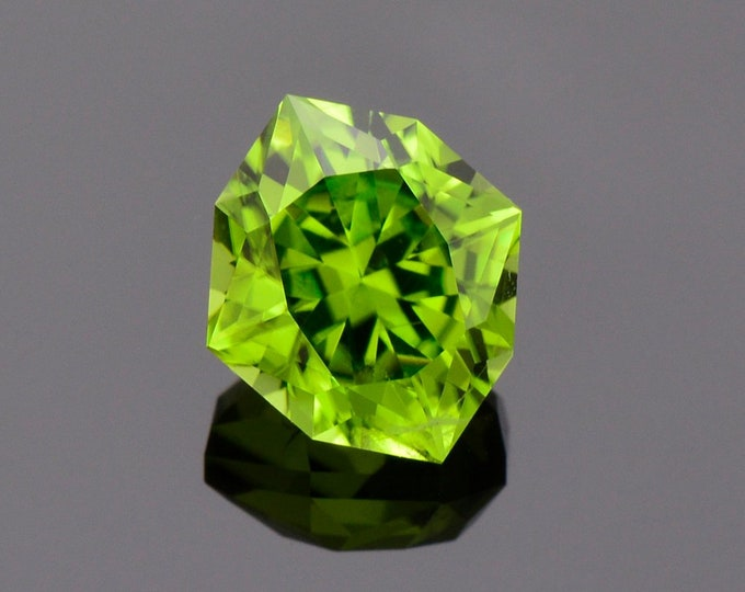 Featured listing image: Fabulous Bright Green Peridot Gemstone, 4.49 cts., 11 x 9 mm., Precision Diamond Brilliant Cut