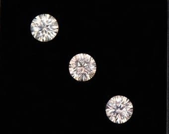 Beautiful Silvery Champagne Zircon Gemstone Set, Concave Round Cut, 2.40 tcw., 5 mm.