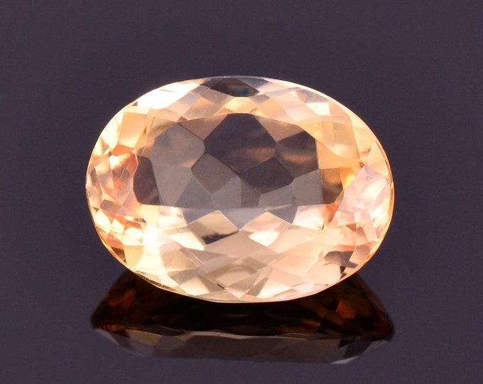 Lovely Bright Yellow Orange Imperial Topaz Gemstone, 1.62 cts., 8.6x6.4 mm., Oval Shape