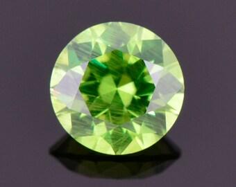 Excellent Green Russian Demantoid Garnet Gemstone, 0.68 cts, 5.3 mm., Round Brilliant Cut