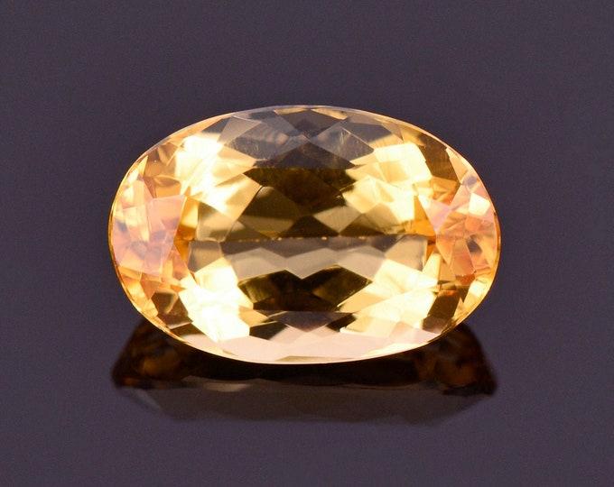 Beautiful Bright Yellow Orange Imperial Topaz Gemstone, 1.35 cts., 8.3x5.5 mm., Oval Shape