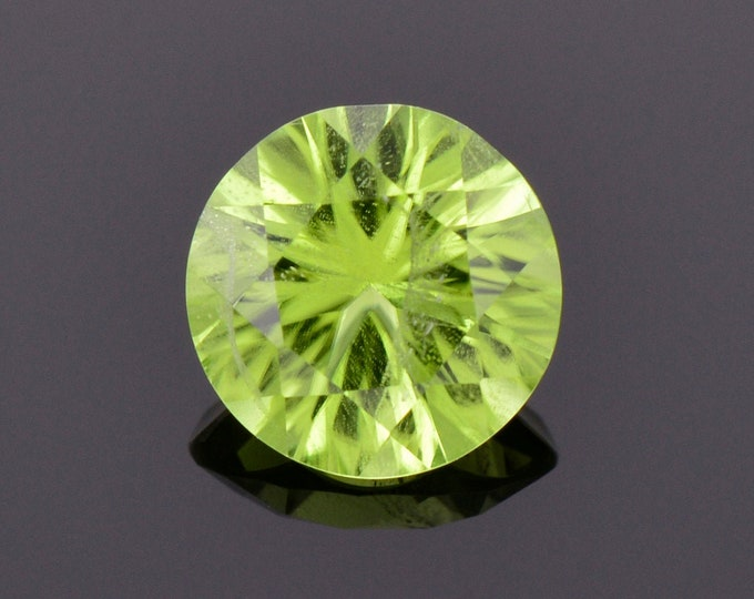 Stunning Lime Green Peridot Gemstone, 1.92 cts., 8 mm., Concave Round Shape
